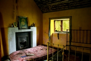 Ghosts of the Faithful Departed interior photo of room with painting of the Sacred Heart of Jesus on display. (Image Source: Photographers.ie)